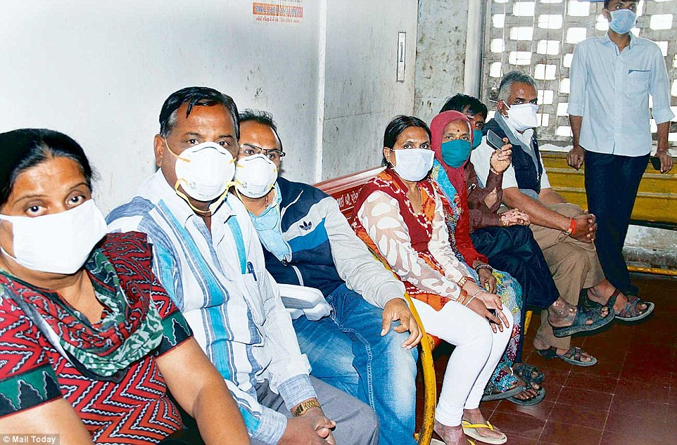 Patients queue up outside the swine flu isolation ward at Civil Hospital in Ahmedabad